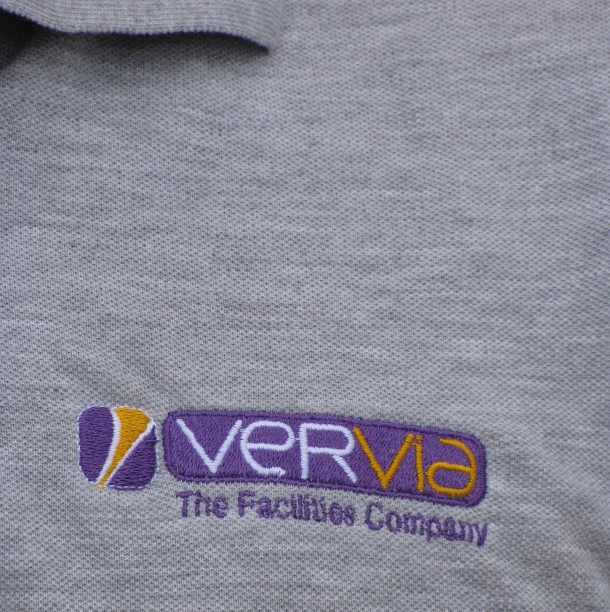 Vervia cleaning logo on shirt