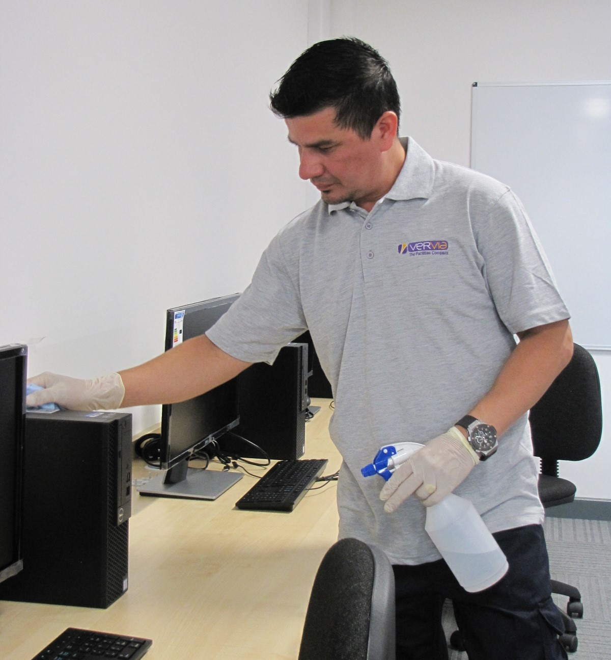 Man cleaning a computer